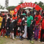 Progressive College players shaking dignitaries at copa coca cola final.