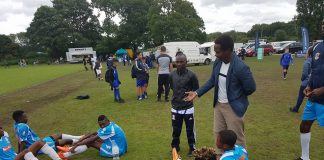 Gafar Liameed addressing Buruj FC players at the Manchester Super Cup