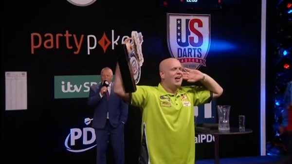 Michael Van Gerwen, Winner of the U.S Darts Masters holds trophy.