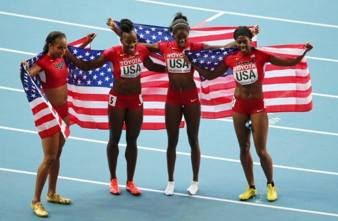 American Athletes celebrate their victory with flag