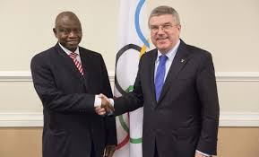 NOC President Habu Gumel exchanges handshake with IOC Presideny Thomas Bach