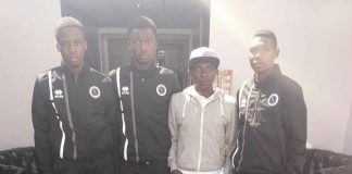 The CEO of Buruj Sports Academy flanked by players of the Academy