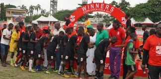 Progressive college,Imo players shaking dignitaries during presentation of medals